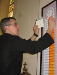 Fr. Parker updating the fundraising chart in church